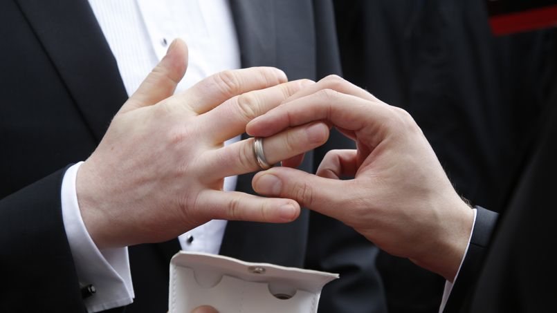 Gay couple Schmitt and Nicolai exchange rings after being married by Copenhagen